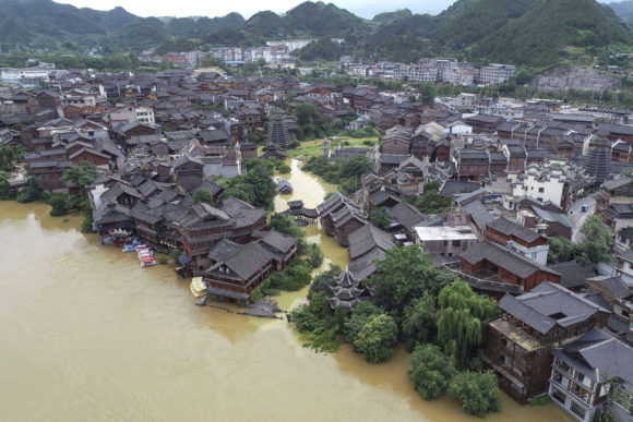 Heavy Rains Batter China, Raising Flood Alert Levels for Cities on ...